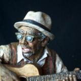 NOBODY LEAVES THIS LIFE BEFORE SINGIN' TH' BLUES
