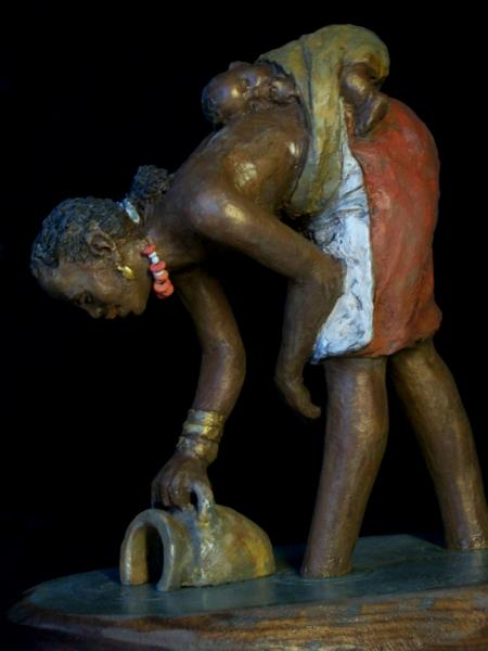 African Woman dipping water with baby
